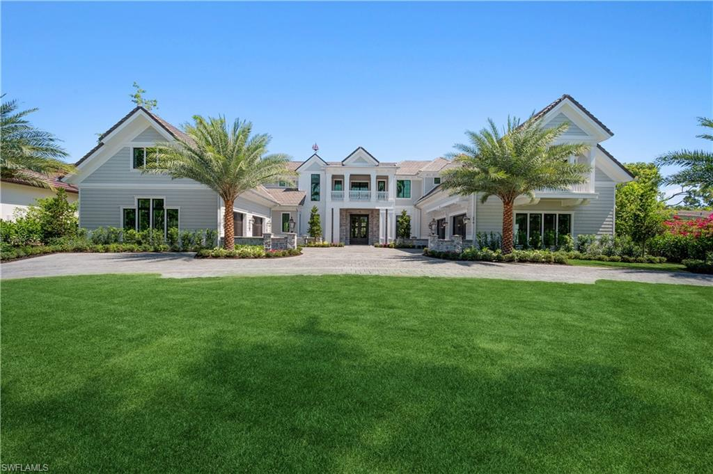 """Just Completed! Custom """"Naples meets the Hamptons"""" Estate Home designed by award winning Tony Boyatt in collaboration with Big Island Builders.  A brand new, one of kind, fully furnished masterpiece with panoramic southern exposure is perfectly positioned on oversized Jack Nicklaus designed Golf Course view lot.  This Grand Estate lies just 1.5 blocks from the world-renowned white sandy Naples beaches. With 13,118 sf, this meticulously designed & fully automated five bedroom + study, exercise room & view room offers the best of everything. Some distinctive details include full concrete construction, elevator, 2 laundry rooms, service kitchen, 60kw generator & the finest finishes throughout. Light & bright estate with a large great room, grand double island kitchen & spacious, fully-equipped, covered outdoor living area is well suited for indoor-outdoor living and entertaining. Outdoor space includes a large pool/spa with sun shelf, fireplace & is completed by automated roll down screens & shutters. With 4 oversized fully finished a/c garages & a beautiful circular cobblestone driveway, this breathtakingly landscaped home is just a short walk to the Olde Naples shops & restaurants."""
