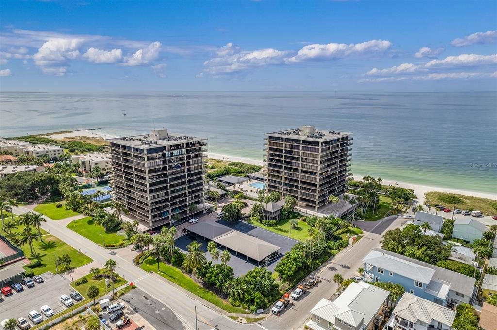 PARADISE AWAITS ON SUNSET BEACH! THE ULTIMATE IN RESORT STYLE LIVING! OFFERING SOUGHT AFTER PRIME SOUTHWEST FACING GULF OF MEXICO VIEWS! Surrounded by both gulf front as well as the intracoastal coastal waterway, with direct beach access to the pristine sandy beaches of Treasure Island. One of the best beaches in the world! Being offered turn key, completely remodeled and tastefully furnished, this beautiful one bedroom one and a half bath condo has floor to ceiling sliding doors to maximize views, together with an expansive 36ft balcony to relax and enjoy both sunsets/stars at night. The ceilings have been opened up for a lofty/soho look, kitchen and baths have been fully updated and new luxury vinyl flooring installed throughout. The convenience of an inside laundry room, and a prime assigned parking place very close to the elevator. The pool with it's large sun deck overlooks the beach and mature tropical landscape setting. Other amenities include: a fitness center, sauna, games room with pool and ping-pong tables, clubhouse room with kitchen, library, outdoor grill, tennis courts, pickel ball, shuffleboard, fishing pier and a long boardwalk for scenic walks. Located in close proximity to a variety of great restaurants, beach bars with live music, shopping centers, parks, community center, golf courses, close to sporting event stadiums and airports. Downtown St. Petersburg, brimming with life, culture and so much more is just a short drive away! Come, claim your maintenance free place in the sun!