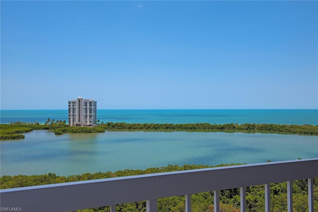 Enjoy panoramic views of Venetian Bay, Clam Pass and the Gulf of Mexico from this 12th-floor St. Tropez residence in Pelican Bay. This southwestern exposure home gives you stunning sunsets plus the twinkling lights of Park Shore and the city at night. Encompassing over 1,400 square feet under air, this two-bedroom-plus-den and sunroom (glass-enclosed lanai) features granite countertops, impact-resistant glass and is being offered furnished. St. Tropez is a low-density building with only 52 units and a recently renovated lobby and common areas. It offers its residents secured entry, on-site building manager, fitness center, pool/spa, tennis courts, social room with kitchen, library, bicycle storage, one deeded parking space, additional storage and guest rooms for overflow visitors. The tram is conveniently located nearby and will take you to the beautiful beaches and beachfront restaurants. Stroll to Artis — Naples and Waterside Shops for entertainment, shopping and dining.