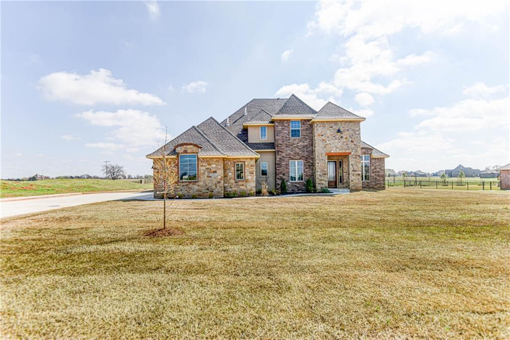 This brand new home sits on a corner lot home in Deer Creek schools! High Quality details throughout such as a Post-tension foundation, spray foam insulation, and gorgeous finishes. This home offers endless space including  4 true bedrooms, an executive office, and a first floor great room with an open floor plan leading to the kitchen. Living room features wood look tile, a stone fireplace, and built-in cabinetry. Large kitchen features state of the art appliances and a center island with a secondary sink. Huge master suite with luxury en suite featuring double vanities and a corner soaking tub. A bonus living room adds additional space and can be used in multiple ways. Other features include a covered back patio and designer light fixtures!