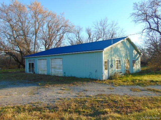 Prime commercial property high traffic count. 731' of road frontage, 5 acres Has a 40 x 56 building on property. Survey on file. 5 acre parcel that is zoned 201 commercial. The possibilities are endless. Located on a hard corner of 32 Mile and Gratiot. Perfect for a storage facility or a supply rental company. Currently has a 2,400 square foot pole barn on the property that needs some work. The structure can be renovated or removed, currently has 200 Amp electrical, Auto Repair, Autos storage , Next to Mobil gas station
