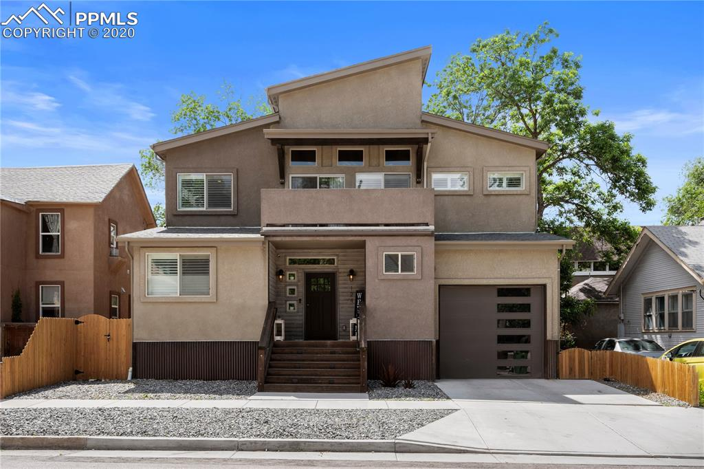 This Modern Home in Downtown Colorado Springs is a must see! Nestled back in an older neighborhood, this home has every modern amenity you could want.  Walk into your stunning open floor plan on the main level and be awed.  Walk out onto the over sized back deck and enjoy the NEW landscaped back yard complete with a peaceful water feature.  Retreat upstairs for the evening in your master retreat with its 11X13 walk in closet and a master bath to envy! The closet has room for anyone and comes with a wall safe for valuables. Your upstairs loft space comes complete with a stylish dry bar and a walk-out balcony where you can enjoy your favorite drink while enjoying the cool Colorado evenings and can watch your kids play across the street in the neighborhood park.  Not only is this house versatile for a large family in just the main and upstairs area, it also has a 2nd kitchen downstairs with 3 more bedrooms and laundry space!  Enjoy family and friends visiting year round with their own living space downstairs or capitalize on an Air BnB operation as you are within walking distance to everything Downtown!  Enjoying your back yard is made easy with plenty of deck space, outdoor ceiling fans, and tons of storage underneath your deck to make organization quick and easy. This home will never feel cramped with its wonderful open floor plan and 9 FT ceilings in the main area.  Upstairs the ceilings are vaulted to 18 FT making the loft area feel even larger!  Every part of this home has the highest quality.  From the Plantation style shutters, to the gorgeous Gas Fireplace and Stone accent wall, to the industrial pipe finishes, this home is the gem of the downtown market!