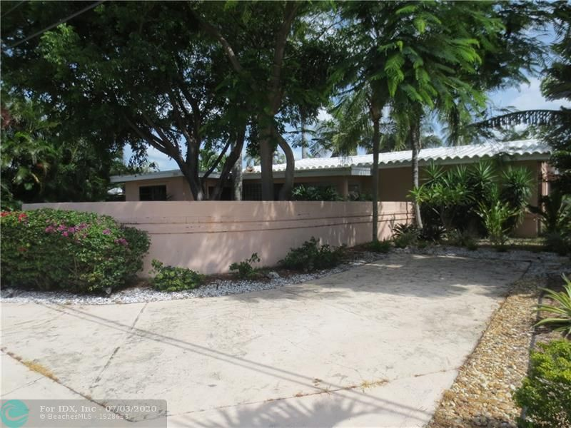 Welcome to the Gated Community in Bel Air.  The Most affordable Single Family option to live Direct Waterfront in Lauderdale by the Sea.   Tropic Isle Canal Overlooks a Wide Turning Basin which makes for easy maneuvering for larger Boats.   Seawall updated and Raised.   Garage was converted to living space and could easily be changed back to a single bay. ( Currently used as a Den and storage area.)  Kitchen was updated and is not original to the house.  Curved Front Entry Wall for privacy gives the entrance a Mid Century Modern Feel.  Screen patio and Open Patio off the Family Room.  Split Bedroom Layout.  Short Walk to Town Beach Entrance. Walking Distance to Sea Ranch Lakes Shops and Restaurants and close to Downtown Lauderdale by the Sea.