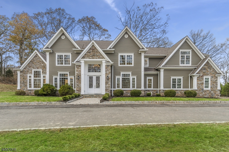 Stunning and Luxurious Custom built home with the finest craftsmanship and detail of the highly known Landvest Construction. Offering 5 Bedrooms, 4.1 baths and 3 car garage. Easy access to 78 and 22. Located on the prestigious Johnston Drive with beautiful winter views.Classic look with a modern flare with top of the line appliances and technology. The detail is impeccable and precise and just what the market calls for. Gourmet kitchen with stainless steel Jenn-air appliances w todays technology, center island, granite countertops and hard wood floors throughout. Open floor plan with 9' ceilings and first floor Bedroom or office. Second floor Mst. Suite is designed for the elite in mind, with two beautiful walk in closets- his and hers and spa like bathroom w an oversized shower and soaking tub.