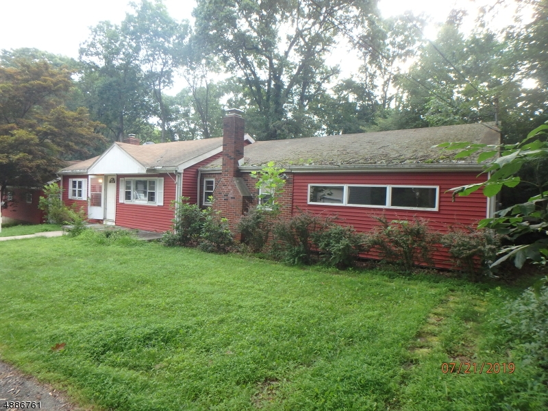 Ranch style home with 3 BR 2 baths, a large 2 car detached garage w/heat, storage sheds. Sold AS IS, all repairs and inspections are the responsibility of the buyer.  Fireplace in the Living room. Brick patio at rear. Nice level lot.