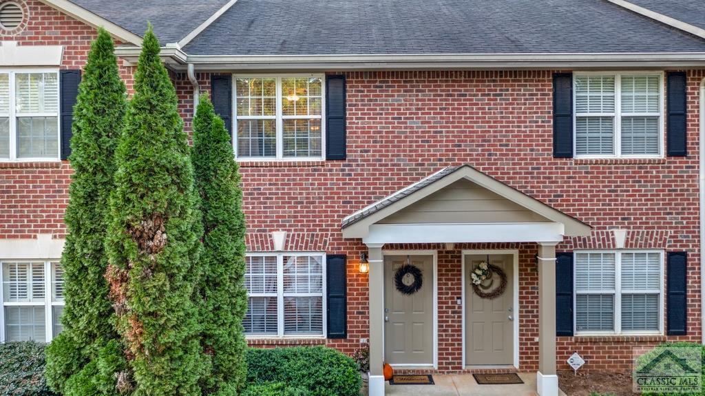 This cute condo has an open floor plan, has been meticulously maintained, and is conveniently located off Barnett Shoals Rd! DETAILS: *2 Bed, 2.5 Bath *1184 SqFt *Built 2002 AMENITIES: *Stones Creek HOA $155/mo includes pool and exterior maintenance *Spacious, open first floor floor plan with high ceilings and great natural light *Neutral paint and flooring colors throughout *Spacious open kitchen with white cabinets, granite counter tops, stainless appliances, a pantry, and a breakfast bar *White cabinets, brushed nickel fixtures, granite counters, and tile flooring in baths *Excellent set up for roommates, with two bedroom suites upstairs *Large back patio area *Convenient Athens location, close to UGA, downtown, entertainment, shopping and restaurants LAYOUT: *First Floor: Great Room, Dining Area, Kitchen, Half Bath, Laundry Closet *Second Floor: Bedroom Suites 1 and 2