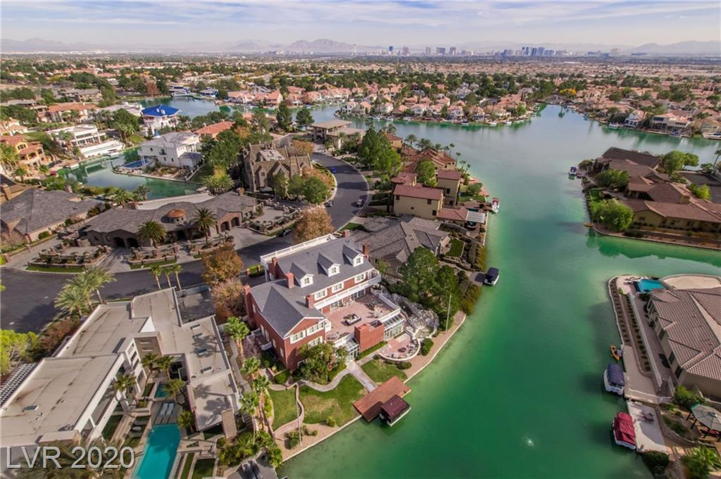Colonial waterfront estate w/private dock, indoor pool & spa, & walkout basement. 1,800+ SF deck overlooking the water. Kitchen w/granite countertops, 2 Sub-Zero fridges, & more. Formal dining, living, & family rooms. Master up w/steam shower, 6-jet tub, wet bar, & balcony access. Office w/built-ins. Gym/dance studio. Wine room. Dumbwaiter system. 53' long storage room. 8-person party boat included. 2 neighborhood tennis courts.