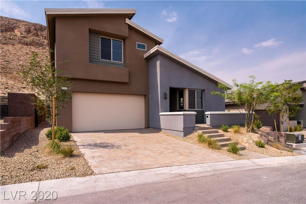 New upgraded 2 story home in Southwest Las Vegas! This home is so beautiful with welcoming entry into cozy living room, flowing into the large bright great room, with sliding doors leading out to backyard. Kitchen is chefs dream with island, built in oven, gas cooktop, and so much more. Dining area looks over backyard. Bedroom and bath downstairs as well! Upstairs you'll find large loft and large secondary bedrooms. Master bedroom is spacious and master bathroom is beautiful with double sink, and huge luxury shower! Enjoy patio cover with  views of mountains! Must see!