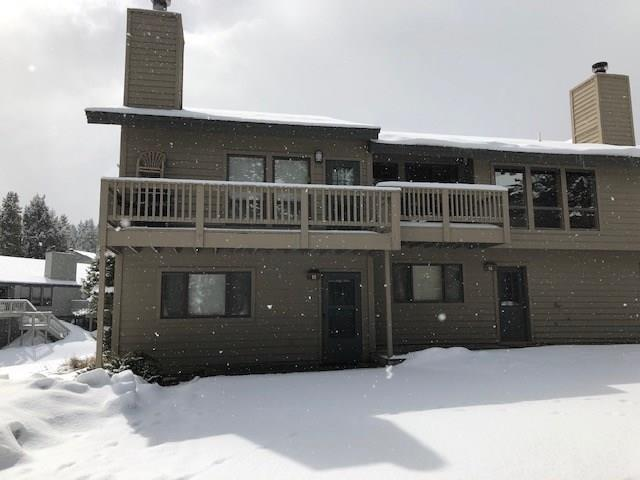 PRIVATAELY LOCATED 2  BEDROOM 2 BATHROOM WITH OVERSIZE GARAGE,  HIDDEN VILLAGE CONDOMINIUM LOCATED IN BIG SKY MT.