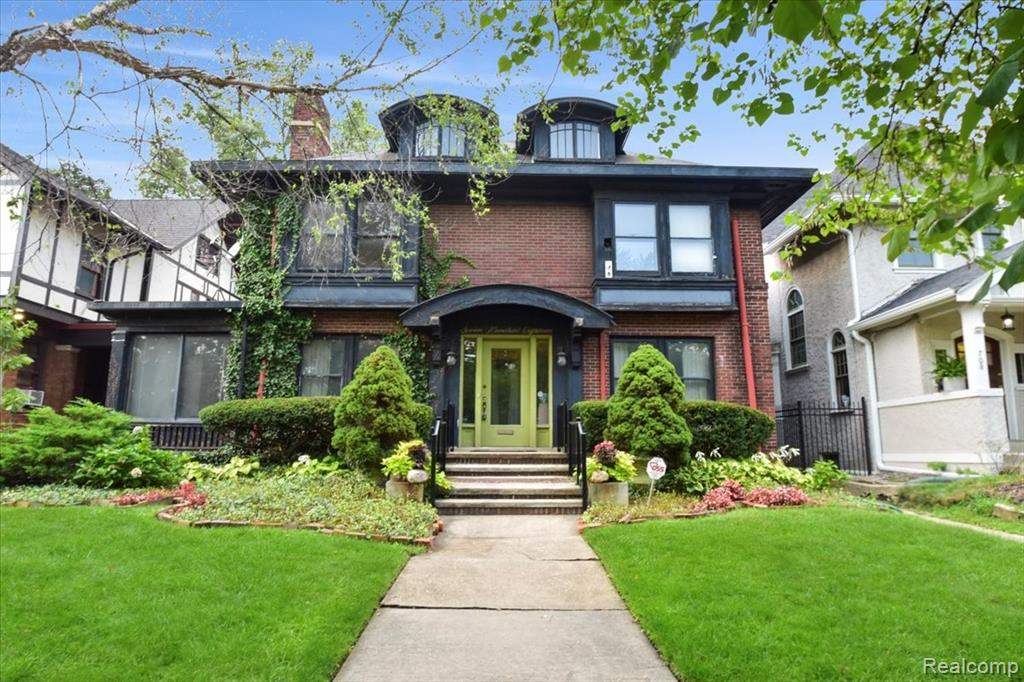 Boston-Edison Historic District right on Voigt Park! This wonderful home has four bedrooms so everyone can have their privacy. The incredible layout, with Servant's Stairs and Butler Pantry, includes a huge formal dining room, an even larger living room with two sets of french doors on either side of the fireplace leading to a wonderful sunroom. Enjoy all the old charm of this lovely home while you entertain friends and family, or make it your special oasis in the big city. The study/music room is properly set apart from the flow for quiet. The second floor was originally four bedrooms, but one was opened up to make an enormous bedroom with three closets. The fourth bedroom is on the third floor and has it's own bathroom. Modern appliances stay for your use. The screen porch in the back is perfect for summer days, or enjoy the garden on the paver patio. Refinish the hardwood under the carpet and make this your Historic Home in the Prestigious Boston-Edison Historic District! Call today