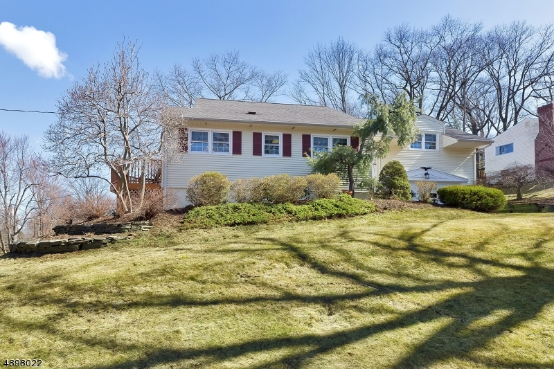 Elegant split level home located in the desirable Murray Hill section of Berkeley Heights. Large, bright rooms with beautiful views through updated thermo-tech windows. Newly refinished (2018) orig Oak HW floors throughout!  Kitchen, 2.5 baths, and CAC all updated. Swarovski crystal chand in DR. Large ground level laundry room. Recently repaved drive. Additional storage area within 2-car garage. Abundance of floored walk-in attic storage. Almost 1,000 sq. ft. of lower level space for extra storage or bonus room. Beautiful brick patio and cedar deck. Easy access to trains, highways, airport and NYC. Minutes from trails and views of Watchung Reservation. Students bussed to Hughes & Columbia schools.3 short blocks from Governor Livingston High School.