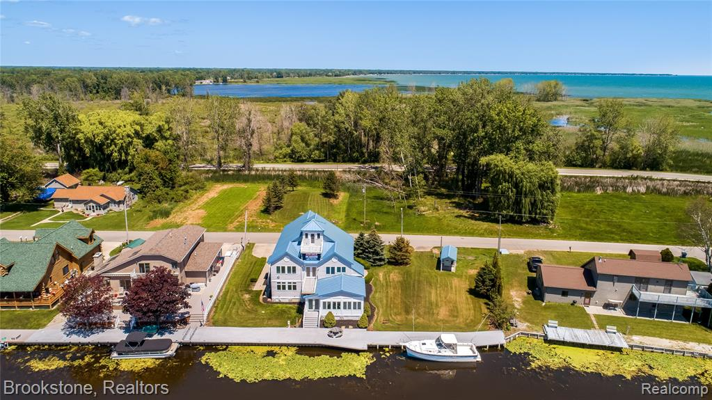 Welcome to 1894 S Riverside. This iconic property is situated at the mouth of the Au Gres river featuring views of Lake Huron, Saginaw Bay, and Charity Island.  146' of seawall topped with trex deck and shore power connection. Over 4000sf of luxury living featuring 5 spacious bedrooms, 1st floor master suite, premium entertainer's kitchen, 2nd floor balcony off of great room, 3rd floor crow's nest with near 360 degree views, commercial grade steel roof, and a sauna house! Anglers and boaters will appreciate immediate access to fuel docks at the Au Gres Yacht Club and open water. This breathtaking home rests on 2 riverfront lots and 2 buildable lots behind the home perfectly suited for a pole barn w/ additional living space and/or boat/rv/toy storage. Schedule your private tour today! 3D Virtual Tour available upon request.