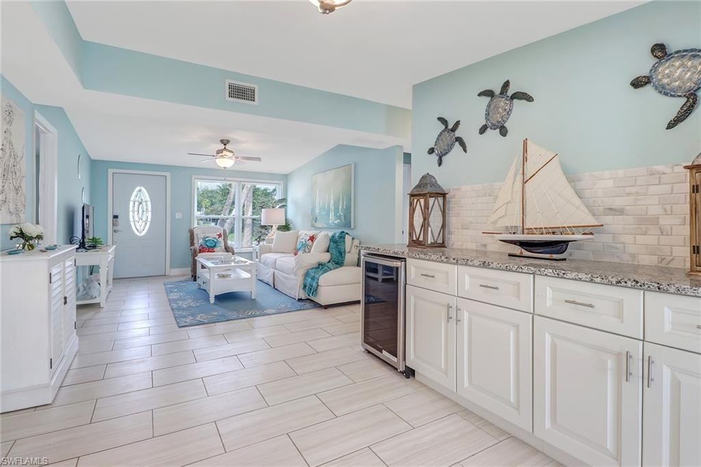 This stylish & remodeled home with coastal flair & decor welcomes you to relax and enjoy all that gorgeous Naples has to offer. Boasting an amazing location that provides quick access to the Naples beaches and 5th Ave shops and restaurants -- just 4-7 minutes away! Also for sale as an Airbnb Bus
