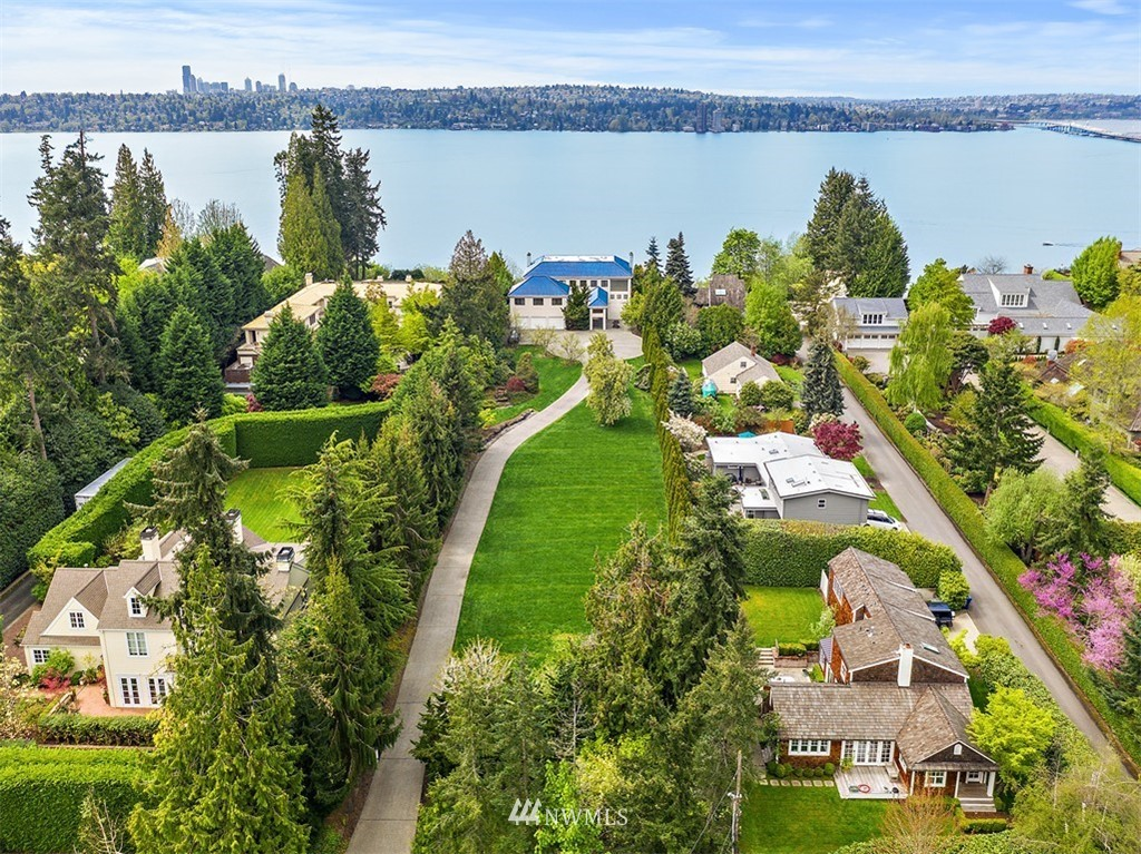 Spectacular street-to-water property rarely available on Medina's Gold Coast. This grand west facing estate sits on 2 acres and 100 feet of Lake Washington waterfront. Enjoy and update the existing grand contemporary custom-built home or build your dream home on Medina's treasured Evergreen Point. An estate of this size offers endless possibilities including subdivision. Expansive western views of Lake Washington, Seattle skyline, Olympic Mountains & glorious sunsets. Medina Elementary & award winning Bellevue schools. Enjoy lakefront living at its finest.