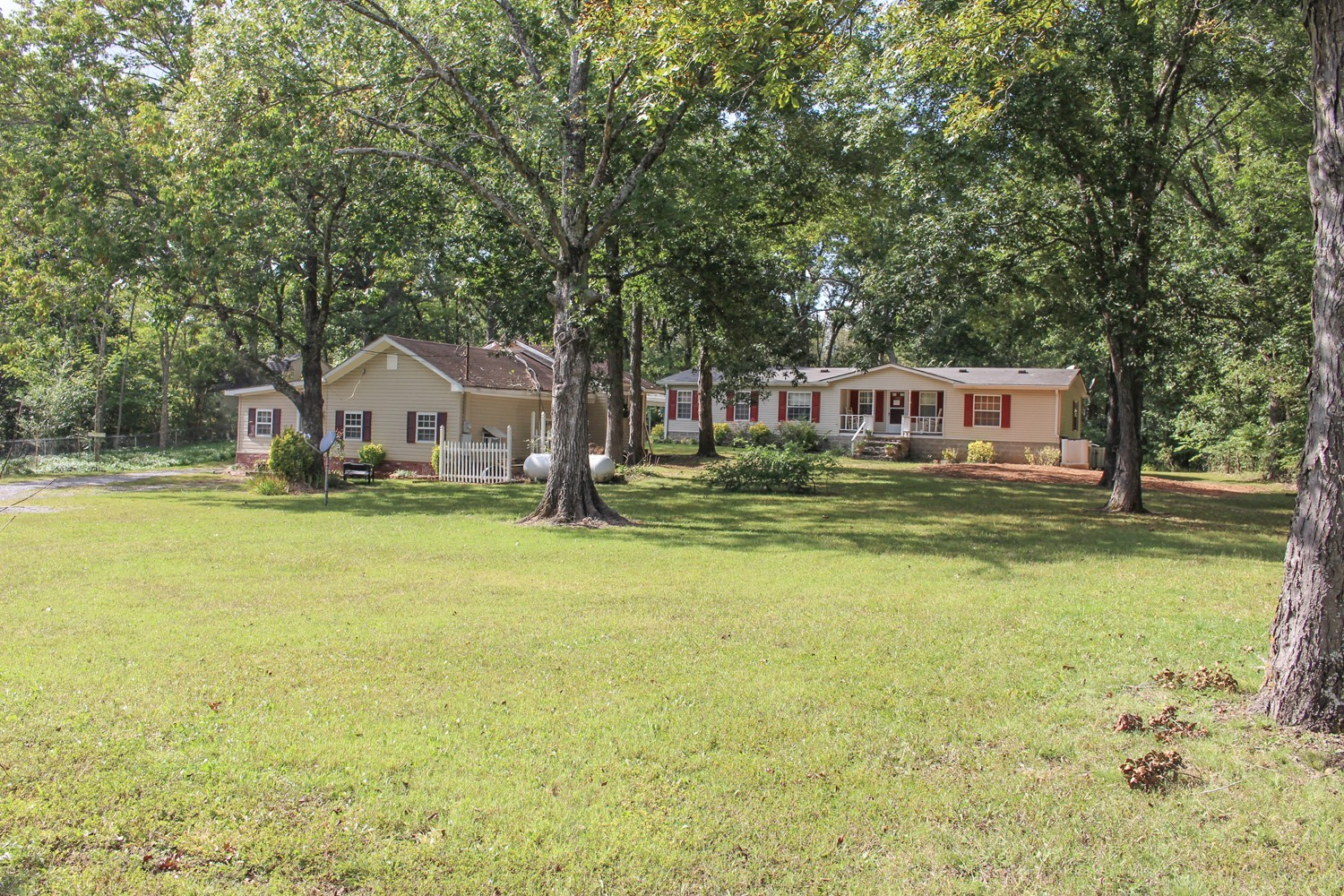 Home to be sold at public auction Oct. 31st, 10:00 AM. 2 Homes 1 Price on 3+/- Acres Home 1 is a 1 bedroom, 1 bath, 1,062+/- sq. ft. vinyl siding home. Home 2 is a clean 3 bedroom, 2 bath, 1994 manufactured home on a permanent foundation with 1,280+/- sq. ft. Home are on approximately 3+/- acres with a barn, large 2 story Dutch barn, 2 carports and a back yard storm shelter. The property is bounded in back by the Corp of Engineers and is very private.