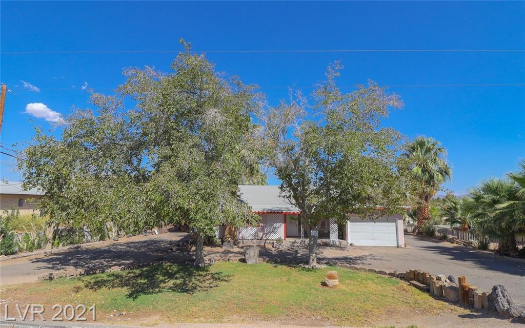 Looking for Property with just under 1 acre at .76 and horse permitted.  This property has ton's of potential, don't miss out on this opportunity. Home features 4 bedrooms, 2 bath, 2 car garage, private well. With a guest house in back with 2 bedroom 1 bath, great room and Kitchen. Property needs some TLC.
