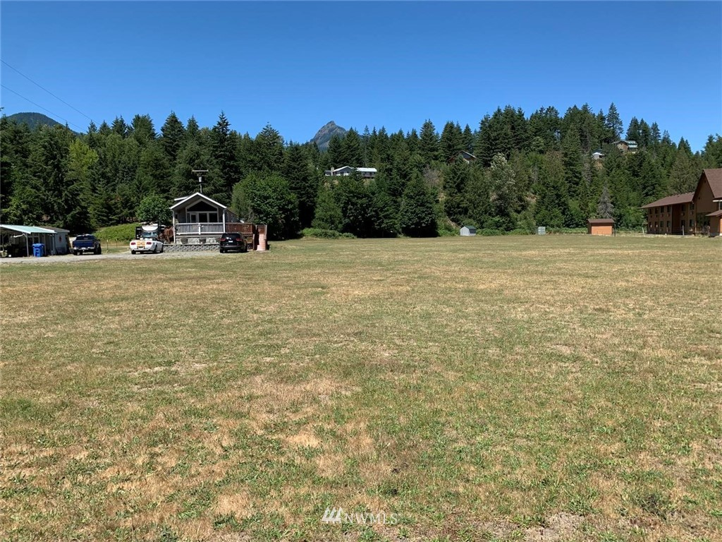 Packwood is booming and this very desirable piece of property sits right in the heart of town. Just off of Hwy 12, this unique five acre parcel is surrounded by commercial development as well as new homes and offers unlimited potential. It is flat, in a prime location, easy to access and close to local services. It also has a quality single wide manufactures home with water, sewer power and additional RV site. Close to the ski area, camping, hiking trails, fishing, boating.