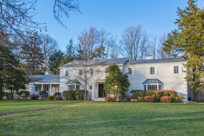 Located at the end of a quiet cul-de-sac on Harding's east side, this stately 7 bedroom colonial is set on more than 4 level acres offering privacy & serenity in a prime location. The well-maintained home features a cook's kitchen with Wolf range, center island, high-end appliances & an adjacent butler's pantry. It adjoins the light-filled family room with fieldstone fireplace & access to the patio & pool. Also on the 1st floor is a huge master suite with new marble bathroom featuring two separate half baths, soaking tub & spa shower. The 2nd floor houses 4 more bedrooms & 3 full baths. There is also a 1st floor wing with 2 bedrooms & full bath providing privacy for guests. This spacious estate home is located just minutes from NYC train & vibrant Morristown & Madison downtowns.