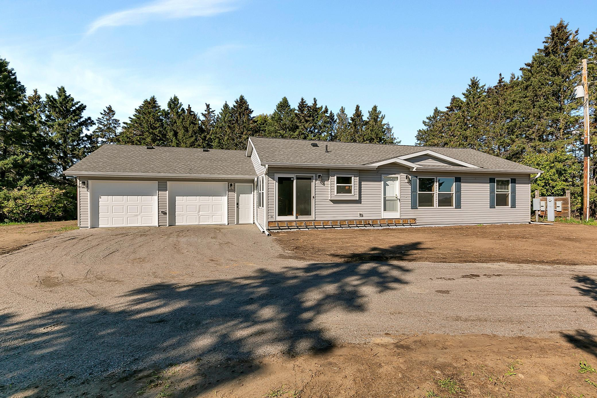 One level living at it's finest! This 3 bedroom 3 bathroom country home sits on a 2.76 acre corner lot just a few miles outside of Holdingford. Master suite with walk in closet, Vinyl plank flooring and a attached 2 stall heated garage are just a few of the great things this home has to offer! Set up your private showing  today!