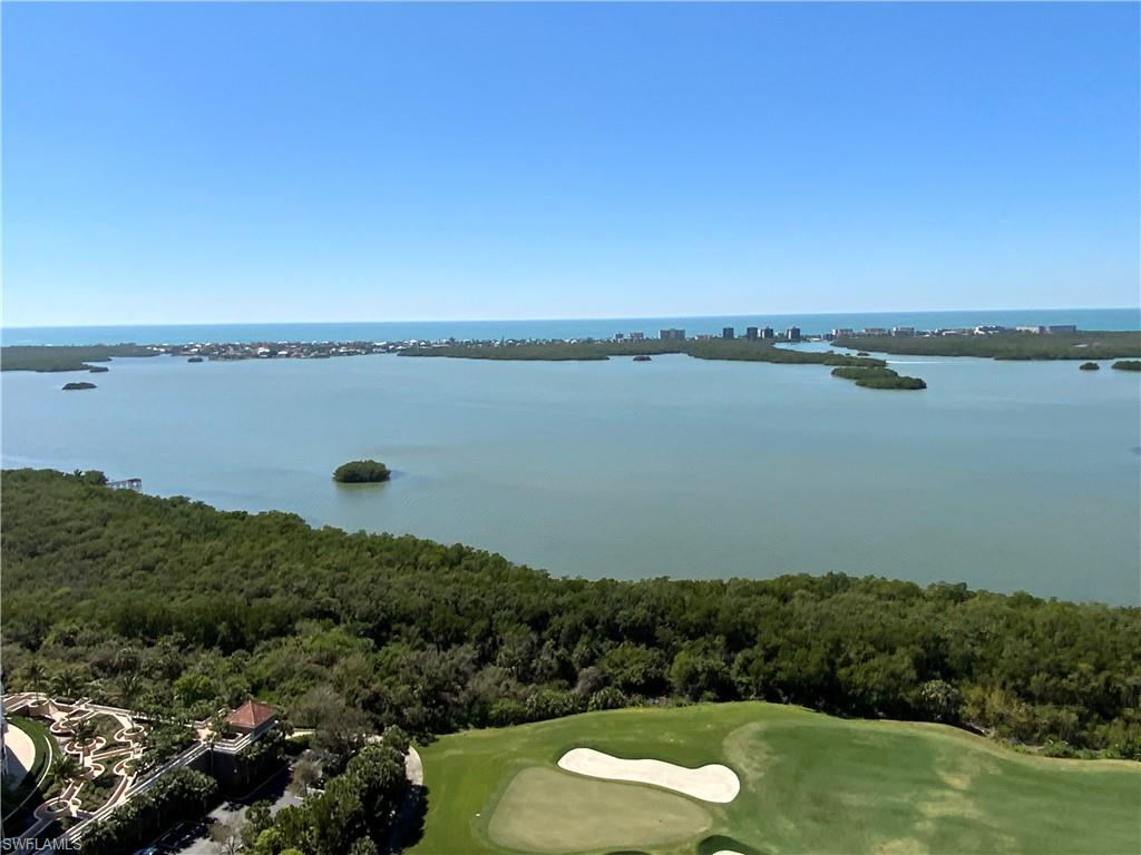 "VIEWS, VIEWS AND MORE VIEWS.  If you are looking for the Perfect Penthouse ""lifestyle"" here it is in Esperia South at Bonita Bay. Enjoy beautiful ""Sunsets"" and views over Estero Bay and the Gulf of Mexico and the Bay Island Golf Course from your Living Area and three Lanais. Currently being installed and updated(NEW) Grill area. New Storm Shutters ($35,000) added to enclosed Patio area so you can leave Lanai Furniture in place during Storms and when you are traveling. The Den can be used as an extra sleeping area when you have guests staying over. Excellent 891 Sq', 2+ deeded Garage with a great location in the private enclosed parking area.  Esperia South has many amenities to enjoy that include the Resort Style Pool area, large outdoor screened Cabana with Bar & fireplace, fitness center, billiards room and Theater.  Social activities include the card room, over 12 Miles of walking and bike paths, marina, and private beach park. Bonita Bay offers a OPTIONAL Golf and or Club Membership that has Five Championship Golf Courses designed by Arthur Hills and Tom Fazio, newly Re-Modeled Swim Club, Tennis and Pickleball complex and State of the Art Fitness Center. GREAT LOCATION."