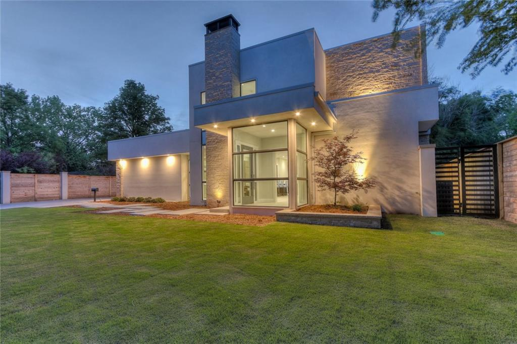 Stunning MODERN Architecture in Nichols Hills Sub.This Custom built home was completd in 2018 & loaded with amenities including Linear Fireplaces w/Stack-Stone Marble, FLOATING Black-Walnut stairs w/stainless rails. The Striking Italian-Marble that sets the kitchen & bar area is coupled with the BRILLIANT Natural Light which Pours through the Dramatic PELLA Windows that grace the Whole House.The Master Suite hosts an Oversized Closet with TONS of adjustable Built-ins; HEATED White-Marble Floors, WALK-IN shower, and a fabulous SOAKER-TUB waiting to take you away. Satisfy your deepest hunger with the 7-Piece Jenn-Air package that fills the kitchen plus the built-in Miele Coffee-Maker in the huge adjustable pantry.Upstairs hosts a large extra-living area, laundry closet, plus 3-comfy bedrooms, equipped with 2 Jack & Jill baths, walk-in closets and built-ins. AND Don't forget the OUTSIDE Living Area with Sensational Fireplace and Sliding-Glass Wall.There is NOTHING LIKE IT on the market!!!