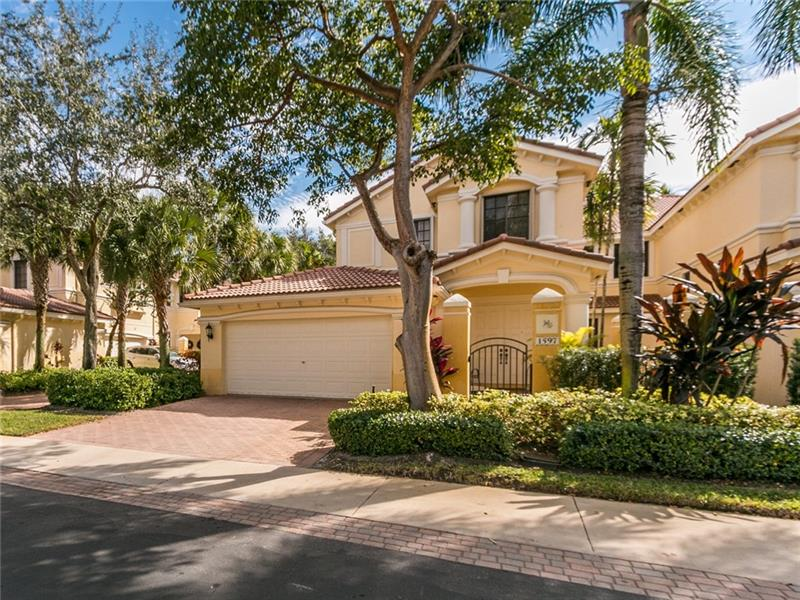 This is THE best priced 2500+sf home currently for sale in Weston. Come see this well-kept 4-bed/2.5-bath townhome. 4th bedroom can be used as a den/office. It has a split bedroom floorplan, tile throughout living areas and carpet in the bedrooms. The inviting courtyard will bring you to the entry foyer with access to/from the 2-car garage. At the top of the stairs you find will your living space, with an open concept kitchen and great room. The guest wing has 2 bedrooms, a bathroom, and a laundry room. At the end of the hall is a large closet that can be converted to an elevator if needed. The open balcony has a garden view and can be accessed from the living area or the owners suite. New Accordion hurricane shutters and AC were installed in 2020.