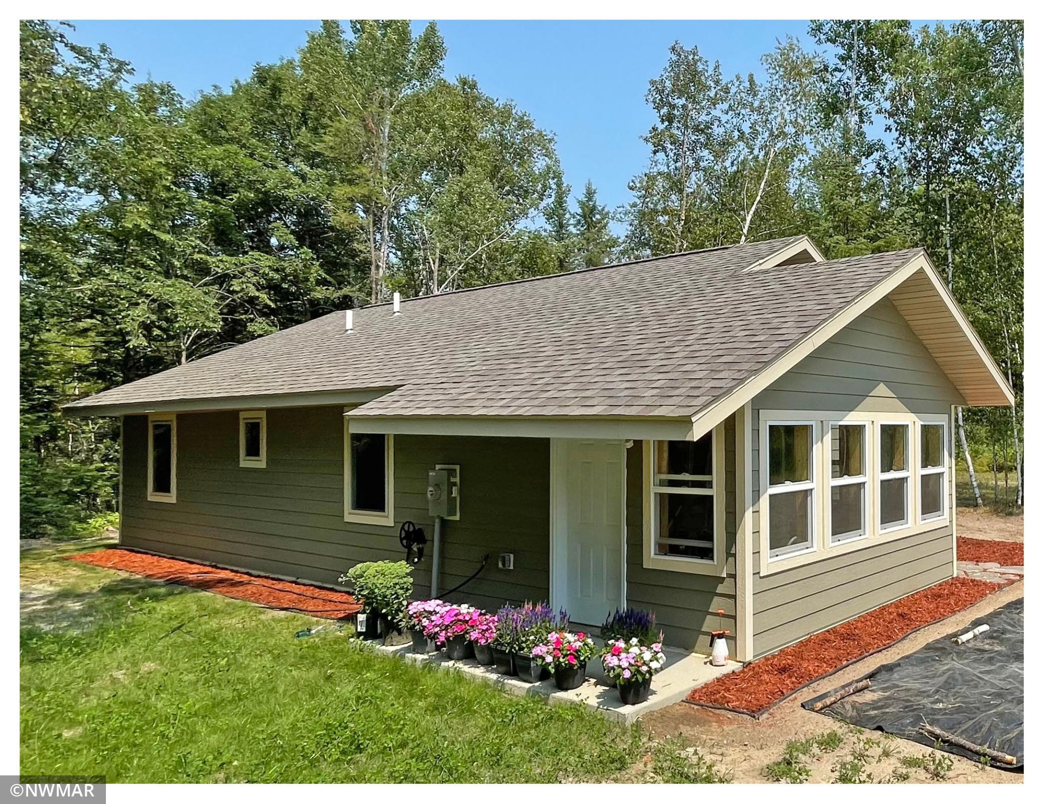 Attention buyers - come be a part of the Wildwood Estates with this newly constructed one level 1BR/1BA home being offered with 9 acres. The development sits in the heart of the of the Cass Lake chain and is only a couple miles from Cedar Lake Casino. Features an efficient 1000 sq ft of open living, 2 sources of heat and ac. Home has handicap accessible bath with walk-in shower. Oversized solid 6 panel doors makes this home easy for those that may need handicap accessibility. Come and be a part of something new!