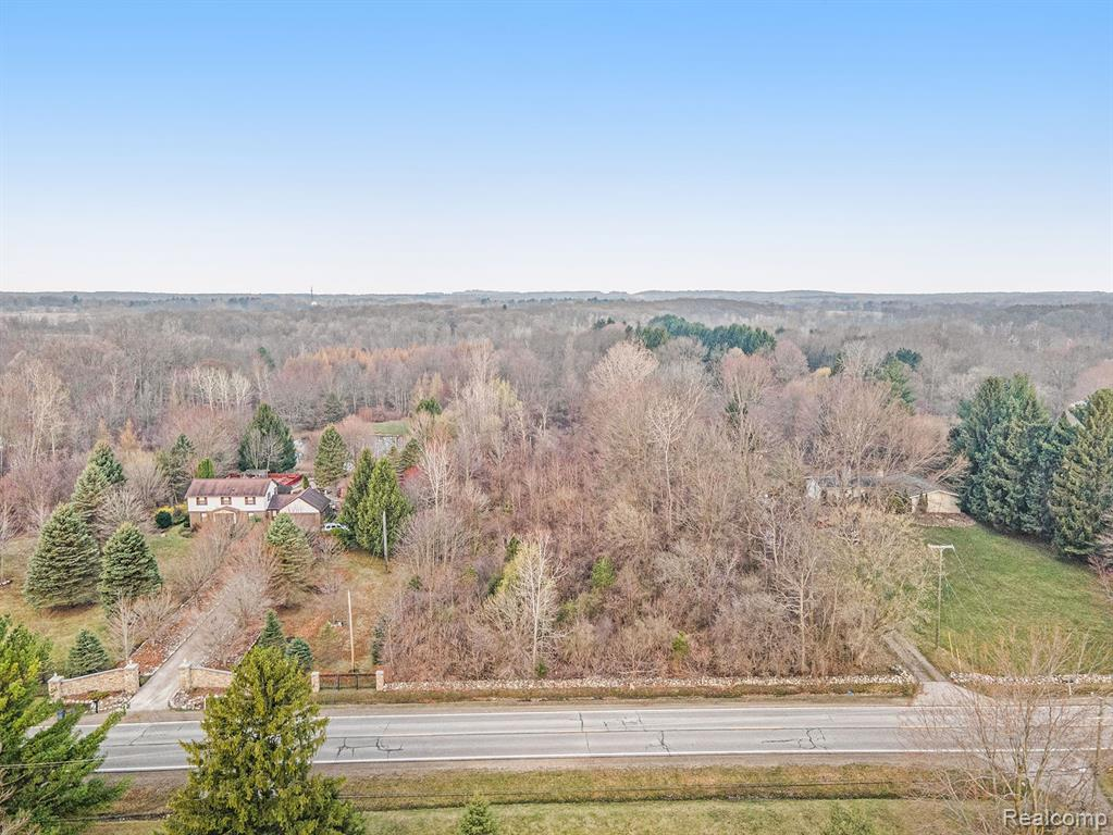 10.055 Acres On a Paved road,  Sanctuary-the creatures of the forest and your family will feel free and secure in this serene country setting that's just minutes away from the city. Gorgeous view of the woods  Wooded land North of 74075 MC KAY ROAD