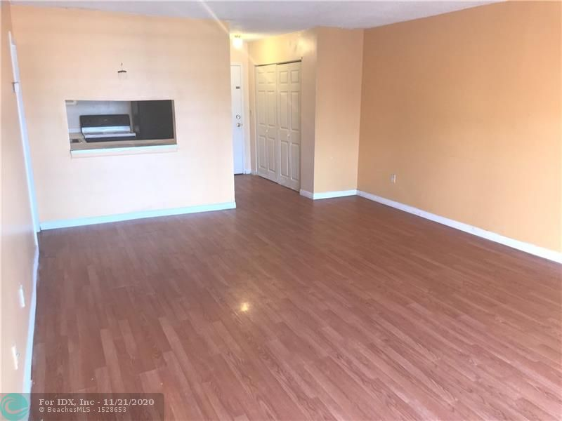4th floor penthouse 1/1 Condo in All age community - Laminate wood floors throughout - Great for an investment property or primary residence - Community Pool - Home has Lots of potential - Close to shopping and public transportation - Easy to show!