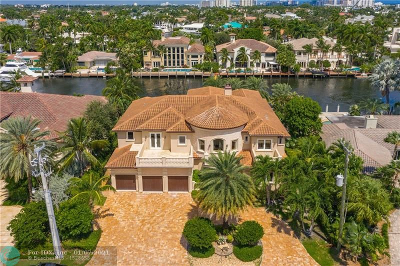 "Amazing opportunity!! Home is located in the highly desirable and gated Harbor Beach community. Just minutes away from the Intracoastal, you are greeted by an open floor making the home perfect for indoor and outdoor entertaining. Exclusive interior items include custom chef's kitchen with superior appliances, a Media room, formal dining room, gym, office, interior & exterior cameras and an elevator. 1 master suite is located on the ground floor, the other master is upstairs and includes a large size walk through closet. Enjoy the outdoor space this home has to offer with a 45' heated pool, outdoor BBQ, spa and a  ""swim up"" wet bar. 95' on the water with accommodation for up to a 75' yacht. Jet ski davit & boat lift. Private Harbor Beach Surf Club and Marina Membership available."