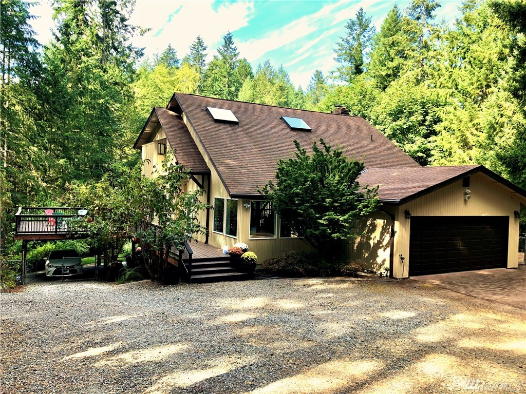 A 2.5 acre private estate surrounded by natural woodlands & sunny gardens, this 3,491 sf custom home offers a quiet refuge only 1 mile from Hwy 16 & Uptown Gig Harbor. Skylights, vaulted ceilings, huge deck w/sauna, new carpets & heat pump. A custom granite island highlights the bright kitchen w/garden views. 4 bedrooms, 3.25 baths, loft/office, master suite w/5pc bath. Self-contained lower level: private entry, 1 bd, bath, office, & full kitchen--perfect for multi-generational or home business.