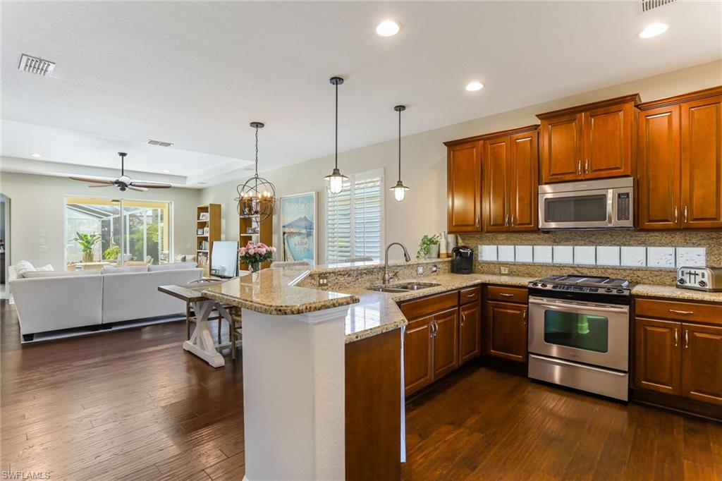 Prime Estero location for this spacious and well-appointed pool home featuring engineered wood floors throughout the living area. Kitchen has upgraded wood cabinetry, glass block backsplash, granite counter tops, Stainless Steel  appliances, walk in pantry and opens to a large dining area. First floor master suite features a walk in closet, master bath with granite duel vanity and separate tub and shower. Downstairs an additional guest bedroom/bath as well with added barn door for privacy. Upstairs you will find a spacious and separately temperature controlled flex/bonus room—perfect for a guest room, home office, or gym! Step outside onto the upgraded travertine tile to your private screened lanai with heated salt water pool. This stunning two story home offers quality through such as plantation shutters, custom wall trim work , designer fans and lighting, and upgraded cabinetry. Popular Gianna floor plan with extended 2 ft added to the garage and master bedroom! Surround Sound in bonus room, living, and lanai outside. The Reserve at Estero is a 24-hour guard gated community, with a Resort Style Pool with Spa, Pickleball, Basketball, Tennis, Fitness Room and much more.