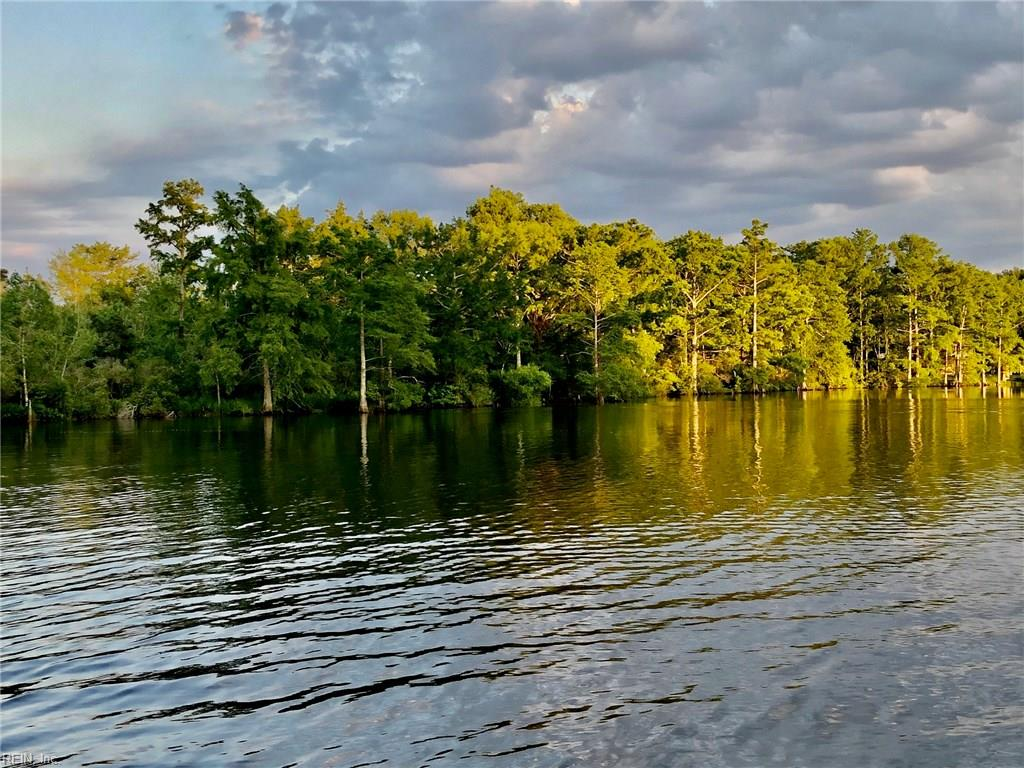A rare high and dry prime waterfront lot located in the exclusive community of Mansfield Farm.Lot #3 is approx.3.4 acres overlooking cypress trees and the Blackwater Creek.The Community of Mansfield Farm is approx.300 acres and has a total of 22 homesite with only fourteen having direct water access.Approx.7 acres of common area and trees at the entrance of the community to give a secluded feel.Lot #3 is mostly clear with a few cypress trees along the waters edge which allows room for horses and outbuildings. The lot has been approved for 1 homesite and should not require flood insurance, but please check with your provider.The Blackwater Creek does flow into the Intra coastal waterway which allows for an easy travel day to Waterside or as far South as Manteo N.C. If jet skies are you pleasurer?The surrounding creeks are mostly wind blocked making almost any day a good boating day ! Boats docks are allowed,but you will have to pull a permit with the Army Corp.for approval. HOA applies.