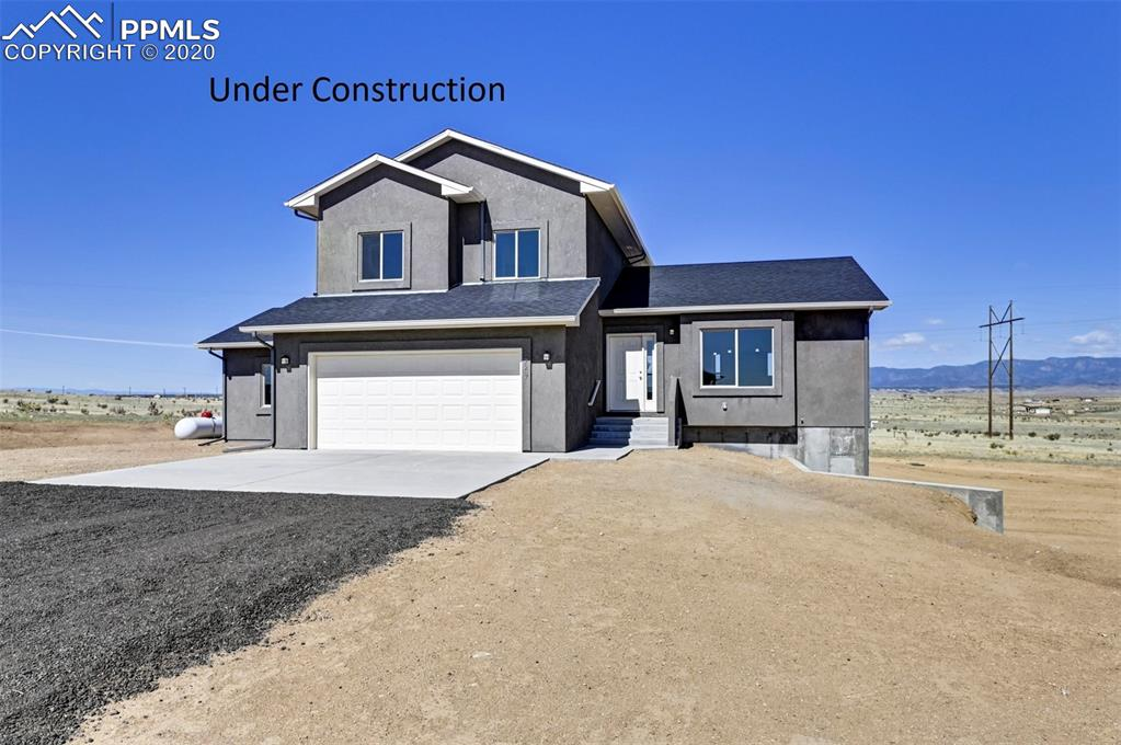 The Monument floor-plan is an open, and welcoming 4 bedroom, 3 bathroom, 2 car garage home. Main Level living, eat in kitchen has an island with counter bar seating, dining nook with bay window. Upstairs are 3 bedrooms. Master bedroom adjoins to walk in closet and full bath with double vanity, and walk in shower. Lower level has family room with walkout to a covered patio. 4th bedroom as well as a full bath are on lower level too. Basement comes unfinished. Carpet comes standard in all bedrooms and living areas. Tile comes in all bathrooms, kitchen, and dining room.  Granite in Kitchen and bathrooms* Stucco is standard.