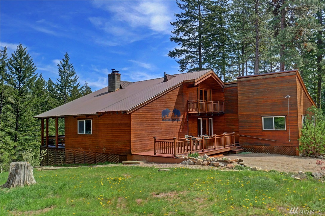 Stunning 3 BR, 2 BA home on 40 acres w/ mountain & territorial views surrounded by a mature forest. Lower level w/ add'l 1 BR, 1 BA, kitchen, separate outside entrance can be used as an apartment or more living space. Deck w/ a view of the Rendezvous valley. Renovated in 2002. Large 2 story garage/barn, includes RV storage, large workshop room, 2 horse stall spaces, & fenced corral. Property bordering WDFW land. Enjoy the diverse mature woodlands & seasonal creek running through the property.