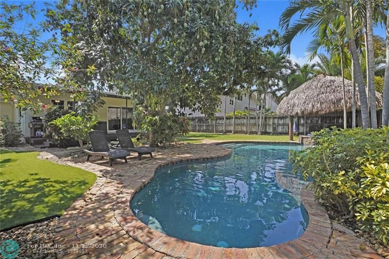 Your private paradise awaits you in the desired southern section of Victoria Park. This 3 bedroom 4 bath home has a spacious resort like backyard with a heated saltwater lagoon-like pool, tiki hut, hot tub and a large covered Trex deck. A chef's delight, the gourmet kitchen with a gas stove opens to a wonderful living/dining room with plantation shutters throughout. The master suite,with french doors, has access to the covered deck and pool area and also features a spacious bathroom with spa shower and separate vanity. Further improvements to the home include impact windows and doors, whole house generator, water filtration system, on demand gas water heater, newer roof (2007/2019). Walking distance to Las Olas restaurants, shopping, parks, and entertainment.