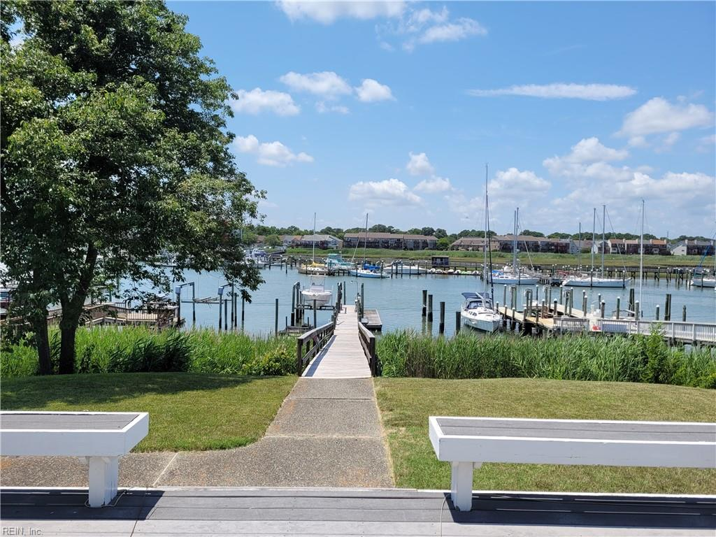 6 ft MLW w/access to Chesapeake Bay!  Private Pier with Boat Lift (10,000 lb), water, electricity, fish cleaning station, 3 floating docks w/xtra tall pilings.  Fabulous views throughout the home, quick access to semi-private BEACH - VERY OPEN floor plan - Adobe style beaded corners, 9 ft ceilings, Great room, eat in kit, breakfast bar, dinette, dining room, large bedrooms, new LVP wide plank flooring, freshly painted interior, glass/vinyl block windows & shower surround.  Crank out Anderson windows, Hunter Douglas shades, built-ins, 2 balconies, all weather screened porch w/removable glass panels,  trex decking, 2 fireplaces, surround sound, canned lights, + more.  Gated community w/tennis courts,  community pool, Marina, ship's store & fueling station.  Resort style living, Golf cart community, pet friendly, Boater's delight.  Come enjoy the Salt Life on Hampton's Gold Coast! Minutes to I-64.