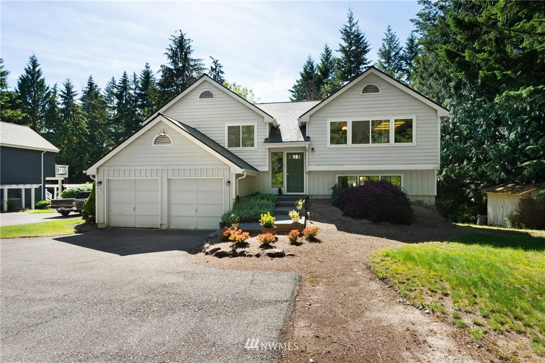 Nestled on the edge of Silverdale minutes to everything! Light & bright kitchen w/newer gas stove, ample cabinetry & pantry. Open dining & living rm w/gas FP. 3 bdrms, including master w/private 3/4 bth, & full bth in hallway. Lower level provides plenty of storage, spacious family rm w/freestanding gas stove, 1/2 bth, laundry rm & 4th bdrm! Generous decks off both levels w covered sitting area & beautiful territorial views. Deep 2 car garage, newer furnace & heat pump w A/C. *H&B Due 6/25 3pm*