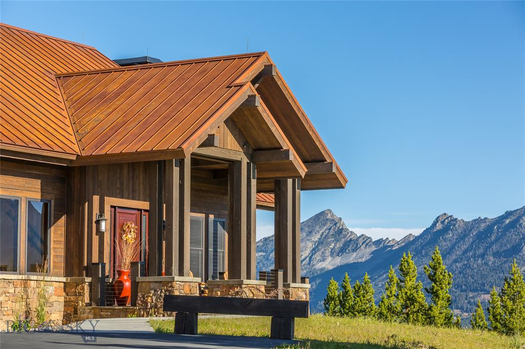 Recently built, this residence sits among the mountains atop the Diamond Hitch Community of Moonlight Basin. With sprawling views in all directions, one can take in the Spanish Peaks or watch the day go by on Lone Peak.  This custom mountain retreat rests on 1.016 acres of land with a 75' ski easement just beyond the back patio, providing amazing ski-in/ski-out access steps away from the lower level ski room. 