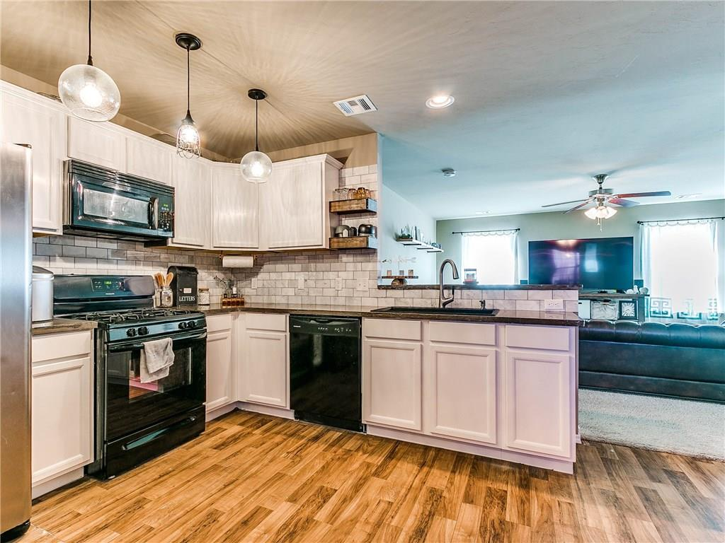 You MUST see this beautifully updated home in NE Moore! Full of designer touches, and with easy access to two major highways, this one stands out from the crowd. From the welcoming large front porch, you walk past a custom sliding barn door into the open living area. Upgraded lighting, countertops, and backsplash in the kitchen add style to the space, which overlooks a bright open living area. The master bedroom and bathroom are on one side of the home, with 2 additional bedrooms and a bathroom on the other. There is so much to love in this home!