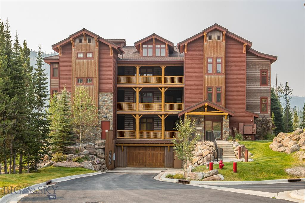 Centrally located in the heart of the Big Sky Mountain Village, this Elkhorn Creek condo has it all - amazing mountain and lake views, convenient access to the great outdoors, and the ideal space that caters to a range of family needs. With vaulted ceilings and an open kitchen/living/dining floorplan this 4 bedroom, 4 bath condo with large loft space, includes a wet bar, and creates the perfect second living room, office or additional space for extra guests. Enjoy your morning coffee on the deck overlooking Lake Levinski and Lone Peak. Offered turnkey this retreat is ready to call home now.