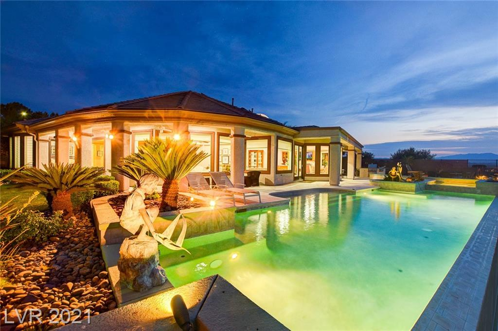 """Sun City Anthem Stunner!  This original Del Webb """"Gold Key"""" model home sits at the T-box on the 18th fairway in this age-restricted 55+ Henderson community.  Walk out of this spacious 4,000+ sq ft home's over-sized sliders to its expansive covered patio overlooking the disappearing edge pool and spa.   Take it all in...the panoramic strip & mountain views.  This over-sized, private corner lot sits right across the street from the community center.  All windows were replaced last year with energy efficient Andersen windows.  Original owners, pride of ownership!  Too many upgrades to mention!  Sun City Anthem is a world class top 55+ community with excellent amenities & activities, two championship golf courses just 15 min away from the fabulous Las Vegas Strip."""