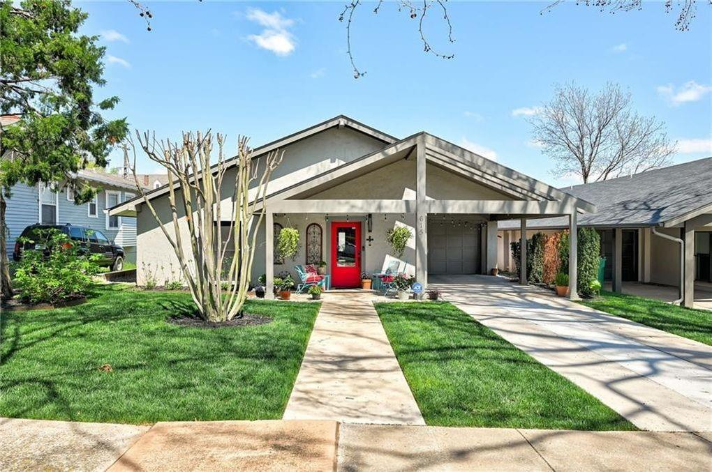 Renovated, beautiful, mid-century, single story home in Mesta Park with large open living space design and tons of natural light. Appliances are high end including Bertazzoni range, top of the line Samsumg dishwasher so quiet… did I forget to push the start button? Industrial style polished concrete floors and unique, fun lighting fixtures and an island that is a dream for large families or party-givers. The living space is perfect for entertaining and offers spacious bathrooms for each bedroom. Utility room is huge for laundry days,  or extra storage. Landscaping is updated with a sprinkler system and a new drainage system.  Close to downtown, NW 23rd, Tower Theatre, Paseo District and  too many excellent eating establishments. This community is active with neighbors out and about walking their dogs and the park is just one block away.  This house features an attached garage which is unique and unheard of for Mesta Park as well as a large carport.