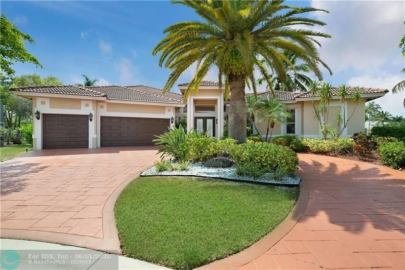 Captivating listing in the exclusive neighborhood of The Isles East in the heart of Coral Springs. One of 115 estate homes in the upscale man gated community. Custom home on oversized 14,000sqft lot with 4 beds, 3 full 2 1/2 baths in the main house and … a CASITA with 1 bed & 1 bath; perfect for guests, office, family or home schooling these days. It sits on over 185 feet of water & comes with a private dock (power & light) so that you can navigate Lake Coral Springs. Oversized 1300 sqft fabulous screened in courtyard patio, with beautiful pool & spa, summer kitchen & the most UNIQUE WIDE WATER VIEWS you will enjoy day in and day out. 3 car garage, accordion shutters & much more. Home Warranty included. Private Park! Perfect for entertaining, 3300 sqft under air ready to make it yours!