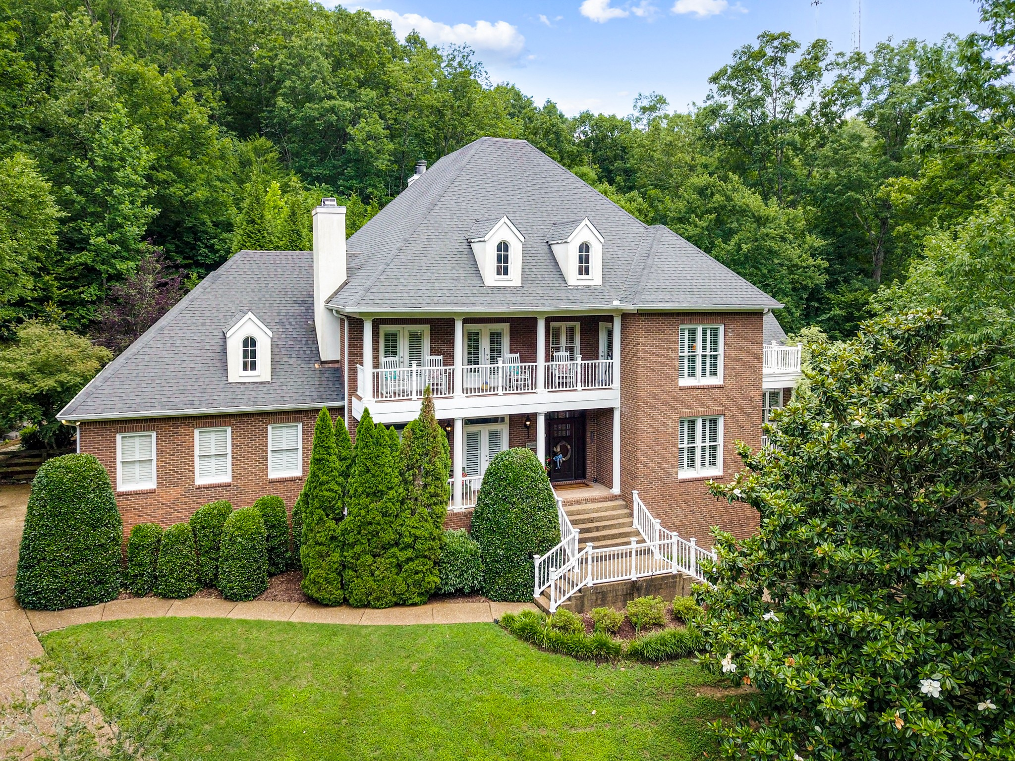 Still showing!!! Serene setting on 5 acres with great entertaining spaces, master on the main with gorgeous updated bathroom, a new stunning kitchen (two dishwahers, two sinks, massive quartzite island)! Private office spaces, huge basement with game room, pub, media room and full bath, garage for 4 cars and a boat plus more unfinished space, screened porch, sunroom, balconies, speakers throughout, gorgeous backyard, loads of wildlife and more! Just 10 minutes to Ensworth High School