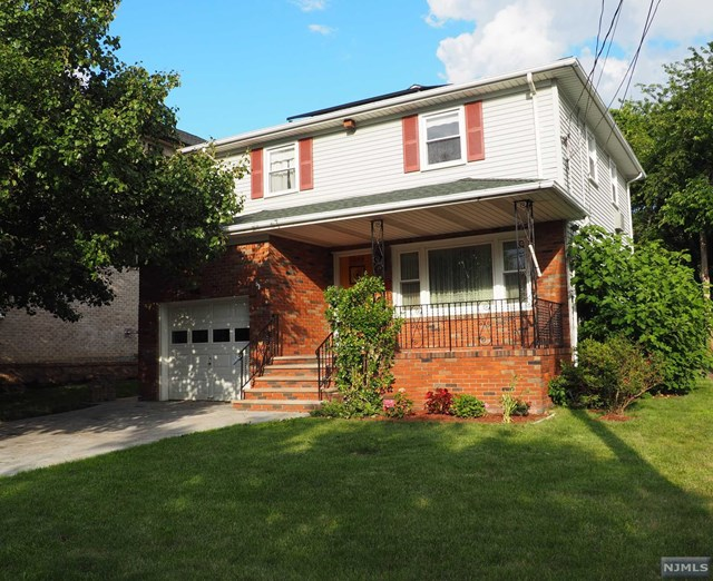 LOVELY BRICK/VINYL COLONIAL HOME LOCATED ON QUIET RESIDENTIAL STREET YET CLOSE TO NYC TRANSPORTATION,GWB,SCHOOLS AND MINUTES TO ALL MAJOR HIGHWAYS.  THIS HOMES INTERIOR FEATURES LARGE LIVING ROOM, DINING ROOM, EAT-IN-KITCHEN WITH BACK DOOR TO PRIVATE YARD. SECOND FLOOR: MAIN BEDROOM WITH FULL BATH, TWO ADDITIONAL BEDROOMS AND FULL HALL TILE BATH. FULL BASEMENT WITH LAUNDRY AND STORAGE THAT CAN BE TRANSFORMED INTO A FAMILY ROOM. BASEMENT ALSO HAS ROOM WITH TOILET/PLUMBING FOR ANOTHER BATHROOM. PAVER DRIVEWAY AND UNDERGROUND SPRINKLERS COMPLETE THE EXTERIOR OF THIS  DESIRABLE HOME!