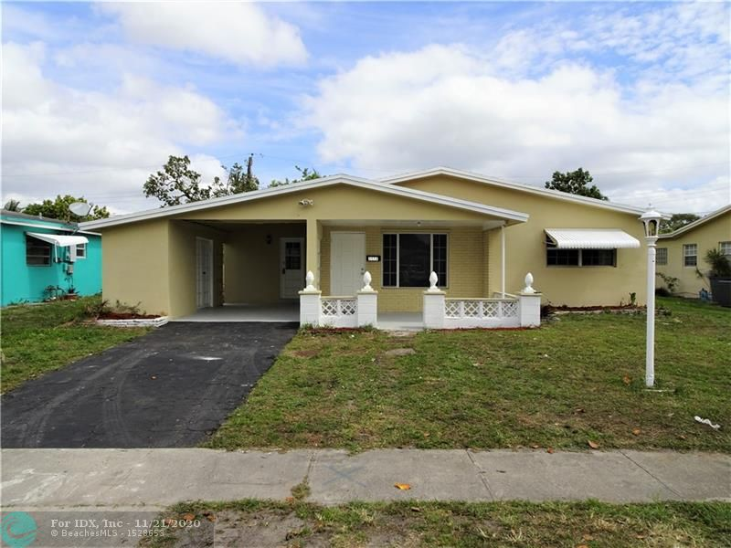 Nicely updated 3 bedroom, 2 bath, Single Family Home in a desirable Lauderdale Lakes location.  This home has many features including; 42in Espresso wood kitchen cabinetry, grey Brazilian Granite Counter-tops, Stainless Steal GE appliances with 12 month warranty, new shingle roof with 7 year warranty, new A/C with 10 year warranty, modern grey waterproof vinyl flooring, updated bathrooms, carport, oversized covered backyard patio, fresh paint inside and out, large storage shed, no HOA, and a private backyard.  VA and FHA are welcomed.