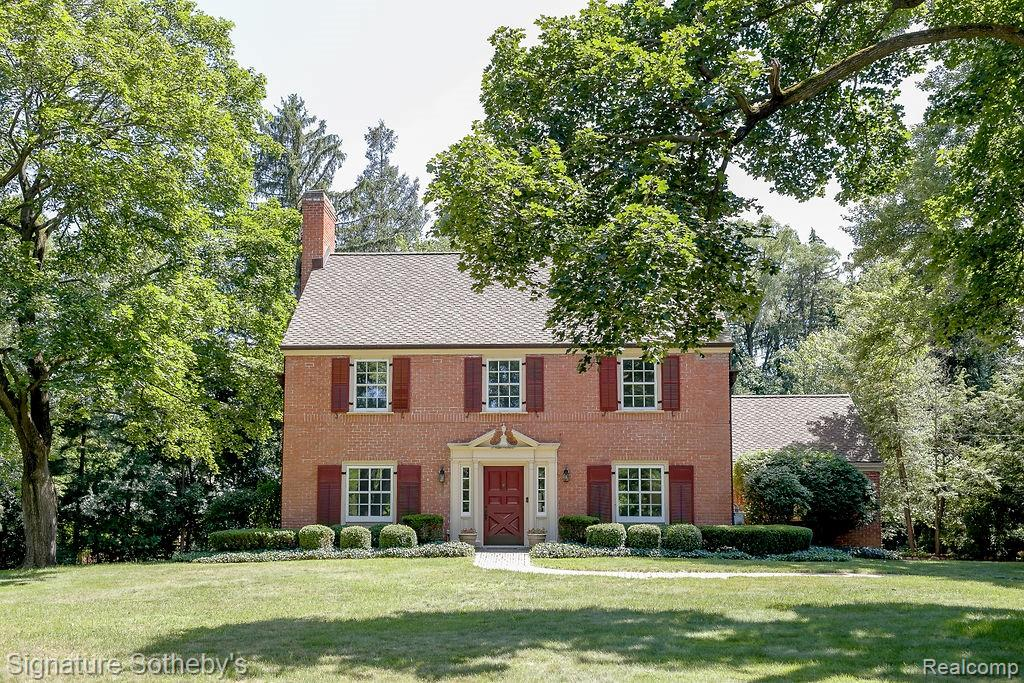 Own a piece of history! This stately red brick colonial was the 3rd home built in Bloomfield Village. Incredible transformation over the painstaking period of 4 years has turned this architectural gem into a modern marvel. With a stunning setting situated on nearly 1 acre of beautiful grounds, the expansive 2700+ sq ft home is showcased by a great room w/oversized fireplace, wall of windows with views to expansive backyard, superior finishes & lighting, multiple living areas, private dining area & exquisite detailing throughout. Sleek & inviting kitchen w/Sub Zero and Wolf appliances & cozy eating area. Master suite provides an elegant retreat w/abundance of natural light, large master bath with dual sink vanities, huge Euro shower and California Closets. Two additional impressive bedrooms on the upper level, beautifully detailed main floor boasts tons of light and doors to one of many patios. Showcasing a private serene ambiance, this sophisticated yet relaxed home is one-of-a-kind.