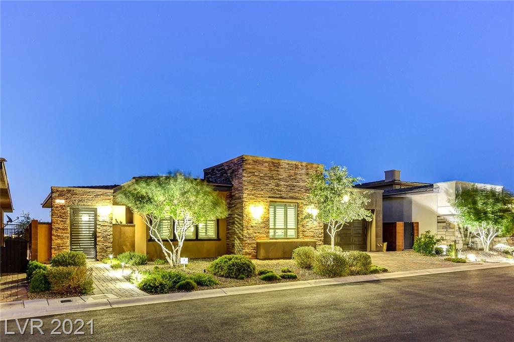 """**NO EXPENSE HAS BEEN SPARED IN THIS GEM THAT SHOWS LIKE A MODEL!! STRIP & MOUNTAIN VIEWS!! OVER $200K IN BUILDER UPGRADES PLUS ANOTHER $175K IN ADDITIONAL UPGRADES!** Located in Regency at Summerlin - a resort-like guard gated, active adult 55+ community by Toll Brothers. Gated, serene courtyard leads to the front door of your dream home that is loaded w/premium details throughout. 12' multi-slide glass doors bring together the luxurious indoor/outdoor living spaces! Gourmet chef's kitchen features quartz counters, custom cabinets, pot filler, walk-in pantry w/custom built-ins PLUS a separate office/desk area. Spacious great room offers 60"""" Primo fireplace w/adjustable lighting, custom shelves & surround sound. Beautiful primary BR w/custom walk-in closet & luxurious bath that has floating cabinets & huge walk-in shower. 2nd BR w/own private bath. 3rd BR w/Murphy bed can also be den/office. Backyard oasis has a sparkling spool w/fire feature, B/I BBQ & separate seating area w/firepit!"""