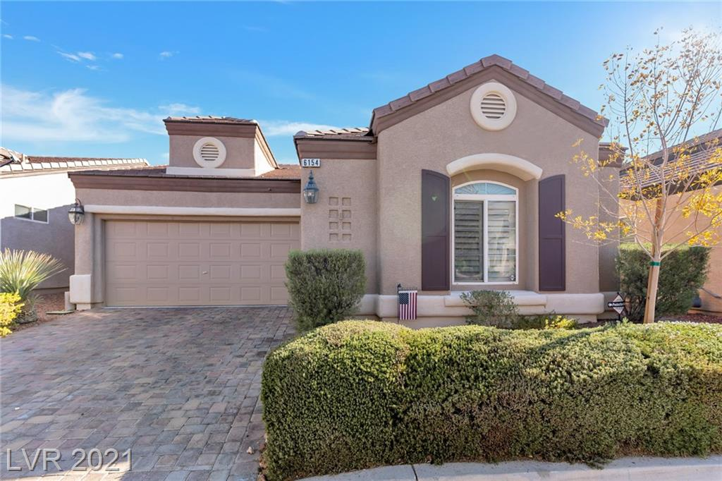 *Detached free-standing (one of only 4), extremely well-kept, charming home in a single-story gated townhome development with community pool, near Summerlin South*  Open floor plan with vaulted ceilings for spacious living. 2 beds, 2 full baths + den/office. Relaxing family room with cozy fireplace. Master bath with separate tub & shower, double vanity and large walk-in closet. Plantation shutters throughout, ceiling fans in all rooms. Solid pine kitchen and bathroom cabinets, with pull-out shelves in kitchen. Built-in oven with separate gas cooktop, large island with breakfast bar and pantry area. Ceramic tile with carpet in bedrooms. Beautifully landscaped backyard with covered patio, pavers, artificial grass, and natural gas BBQ grill. Refrigerator, washer, dryer less than 5 years old. New in 2020, water heater and garbage disposal. Just waiting for you to MOVE IN!